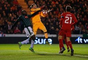 Plymouth's Paul Arnold Garita helps Liverpool keeper Loris Karius drop the ball.