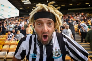 A Newcastle United fan at at Carrow Road wearing his wig in support of recent signing, Allan Saint-Maximin.