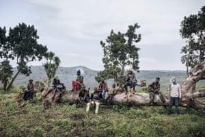 Members of the Codeco militia guard a meeting between its leaders and a delegation of former warlords sent by Felix Tshisekedi, the Congolese president, to negotiate peace, in Wadda, Democratic Republic of the Congo