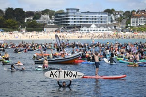 Falmouth, Cornwall, EnglandSurfers, paddleboarders and kayakers take part in a protest in the waters off Gyllyngvase beach during the G7 summit