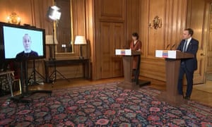 Jenny Harries and Matt Hancock at a Downing Street press conference where they responded to questions submitted via Zoom.