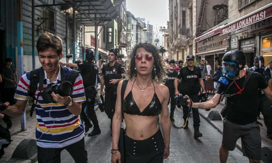 Turkish anti-riot police officers attempt to disperse demonstrators gathered for a rally staged by the LGBT community on Istiklal Avenue in Istanbul.