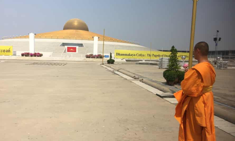 A monk stands inside the temple north of Bangkok