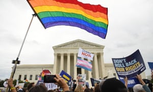 Demonstrators in favour of LGBT rights rally outside the US supreme court on j8 October 8, 2019, as the court holds oral arguments in three cases dealing with workplace discrimination based on sexual orientation.