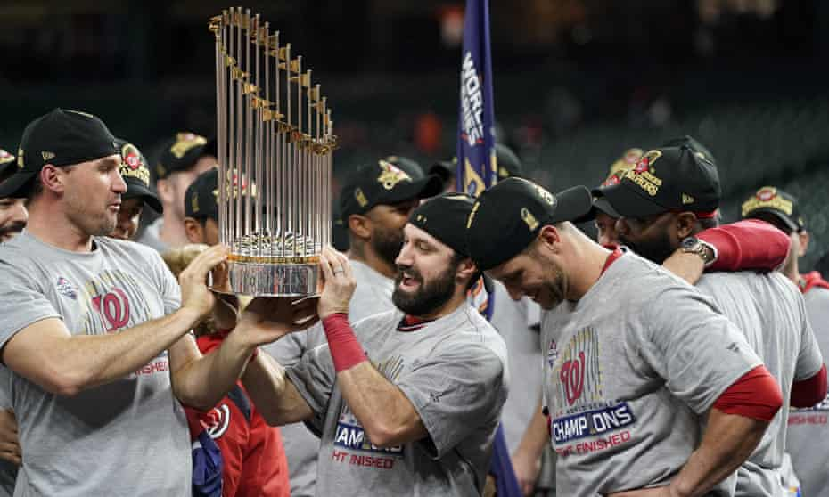 The Washington Nationals celebrate with the trophy.