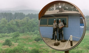 South Korean soldiers at a guard station look out at North Korean territory outside the demilitarized zone that separates the two halves of the Korean peninsula.t