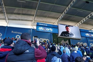 January 20: Huddersfield Town fans watch a message from recently departed manager David Wagner on the scoredboard at half time against Manchester City.