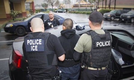 A man is arrested by Immigration and Customs Enforcement officers in Los Angeles.