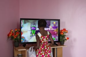 Manchyta watches a cartoon on TV in Saint-Denis, Paris