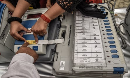 An election worker learns how to operate a voting machine.