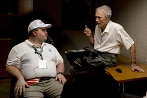 Clint Eastwood speaks with actor Paul Walter Hauser as they work during the filming of Richard Jewell.