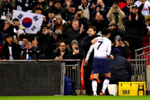 Spurs' Son Heung-Min is hugged by his manager Mauricio Pochettino, after being substituted.
