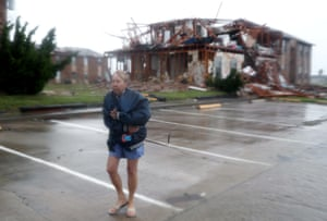 Jacque McKay walks through the apartment complex where she lives on Saturday in Rockport, Texas. McKay said she was able to rescue her dog but lost pretty much everything else.