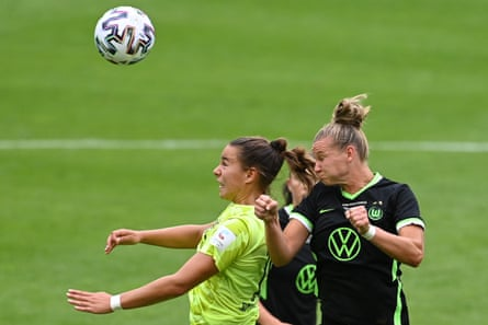 Wolfsburg's Alexandra Popp challenges Lena Oberdorf, then playing for Essen, in the German Cup final in July.