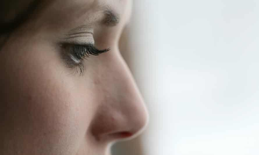 Closeup Profile of Depressed Young Woman