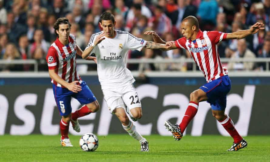Ángel Di María of Real Madrid takes on Atlético's Tiago, left, and Miranda during the all-Madrid Champions League final in 2014.