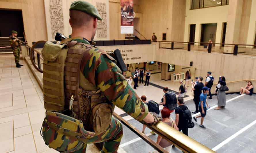 Belgian soldiers stand guard at Brussels' central station the day after the attempted attack