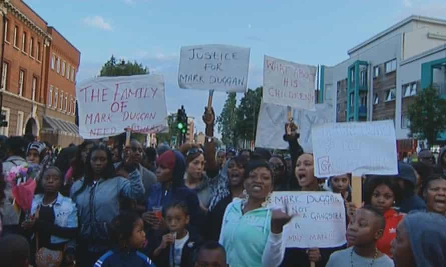 People protesting the killing of Mark Duggan in 2011.