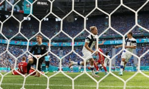 Finland's Joel Pohjanpalo celebrates a goal that is later disallowed.