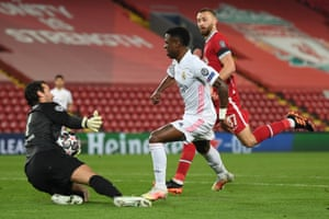 Vinicius Junior of Real Madrid has a shot saved by Liverpool keeper Alisson.