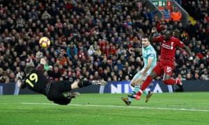 Sadio Mane strikes the ball into an empty net.
