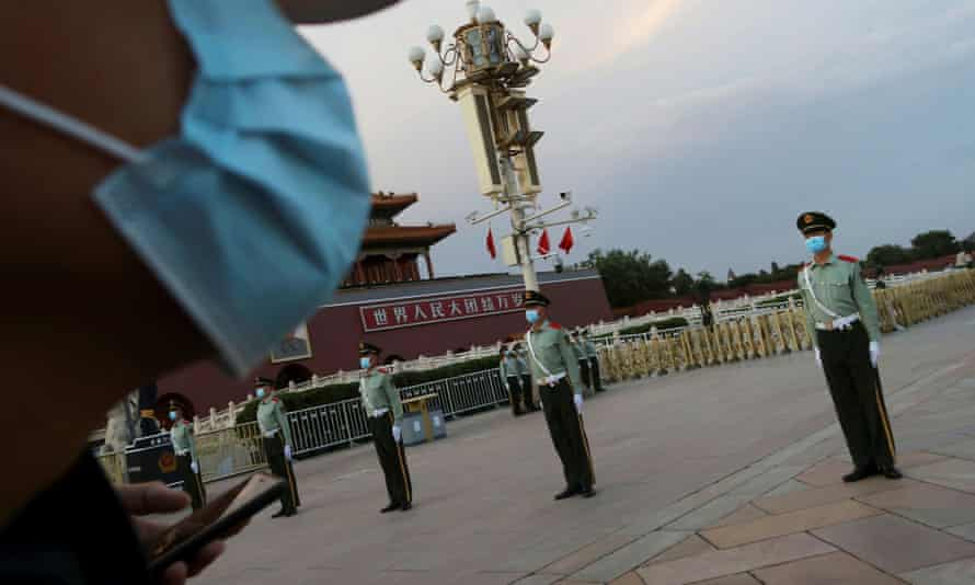 Police guard Tiananmen Square ahead of the National People's Congress, which opens on Thursday.