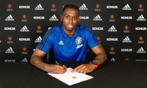 Aaron Wan-Bissaka poses after signing for Manchester United.