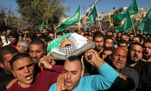 Mourners carry the body of Mohammed Ahmad Khalil Kawasbeh, one of the latest young men from Saer to be killed by Israeli security forces.