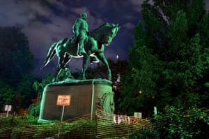 Lynching Site in Charlottesville is Finally RecognizedCharlottesville has been a flash point for those who are both for and against Confederate monuments being displayed in public spaces. Earlier this year the shroud that had obscured the (pictured) Robert E. Lee statue in Charlottesville, Va.'s, Emancipation Park since last August was ordered removed by a judge who deemed that the cover was obstructing the right of the public to view the memorial. -120 years ago a black Charlottesville man, John Henry James, was lynched by a mob near the railroad tracks not far from downtown, Charlottesville, Virginia. Today the site of the lynching was recognized and dirt from the crime area was collected. Some of the soil will be taken to the Lynching Museum and Memorial in Montgomery, Alabama.