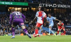 Manchester City's Riyad Mahrez scores their fifth goal.