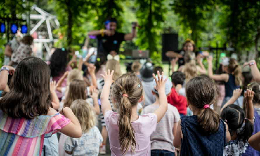 Children watch performers at the NGV's summer festival for kids