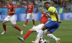 Stephan Lichtsteiner challenges Neymar during Switzerland's 1-1 draw with Brazil in Rostov on Sunday