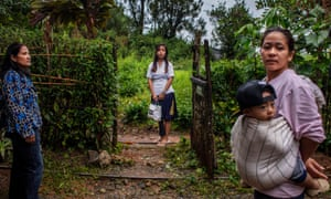Tublay, Philippines, August 2019: Three generations of women gather at the entrance to their house. Donna is absent.