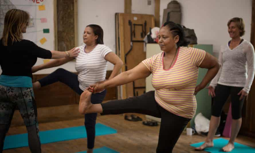 Women are put through their poses by instructors at Ourmala's course in Hackney, east London