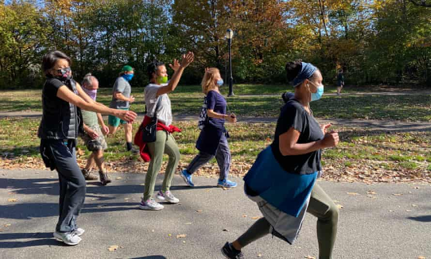 People participate in a dance walk in Prospect Park organised by dancer and documentary maker Joanne Nerenberg.