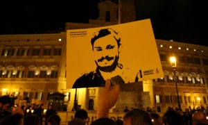 placard bearing likeness of Giulio Regeni at an outdoor commemoration in Rome