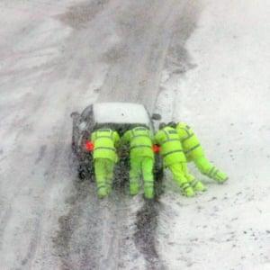 Police push a car on the M80, near Haggs in Glasgow.