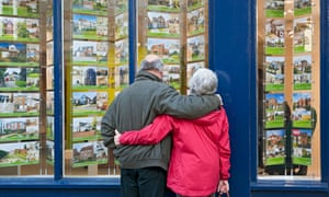 Older couple looking in estate agents' window