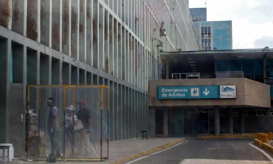 People line up to enter the emergency room of Maracaibo's University hospital on 2 July.