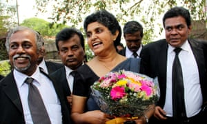 Sri Lanka's former chief justice Shirani Bandaranayake is greeted by lawyers at the Supreme Court complex in Colombo on January 28, 2015, after new Sri Lankan President Maithripala Sirisena restored her position saying that her sacking two years ago was illegal.