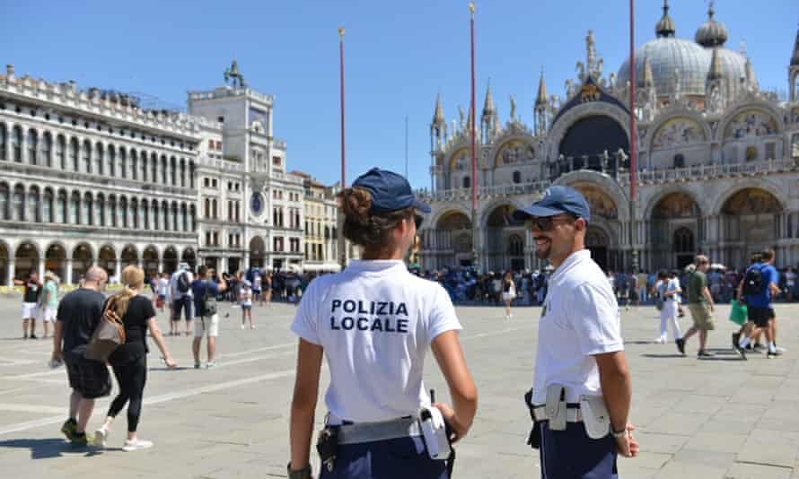 Police keep a watchful eye in St Mark's Square.