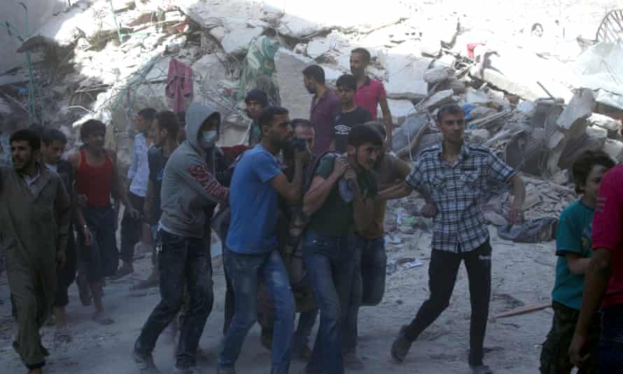 People are pulled from the rubble this week in east Aleppo after airstrikes this week.