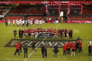 The Wales team celebrate with the Triple Crown Trophy.