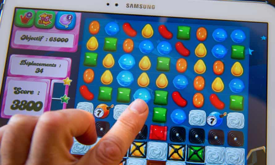 A person plays on his tablet with Candy Crush Saga games developed by British King Digital Entertainment