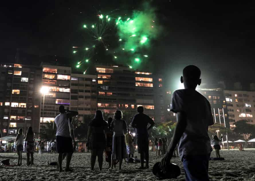 People enjoy of the end of the year celebrations at Copacabana beach in Rio de Janeiro.