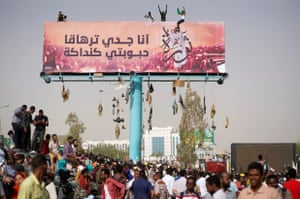 Demonstrators climb billboards during the protest