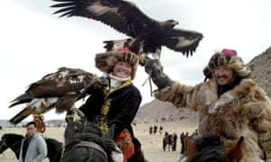 Aisholpan and other eagle hunters at the Golden Eagle Festival.