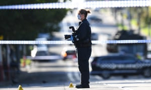 Forensic police work at the scene of a stabbing in Kew, Melbourne on Thursday. Two people were stabbed to death and a man was shot dead by police in a series of violent incidents in Melbourne's inner east on Wednesday night.