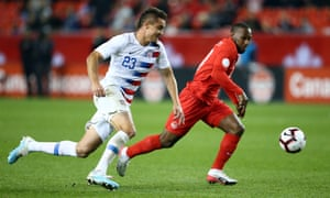 Aaron Long battles for the ball with Junior Hoilett, during Canada's victory over the US on Tuesday night
