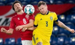 Denmark's Thomas Delaney (L) and Sweden's Mattias Johansson vie for the ball during their friendly on Wednesday night